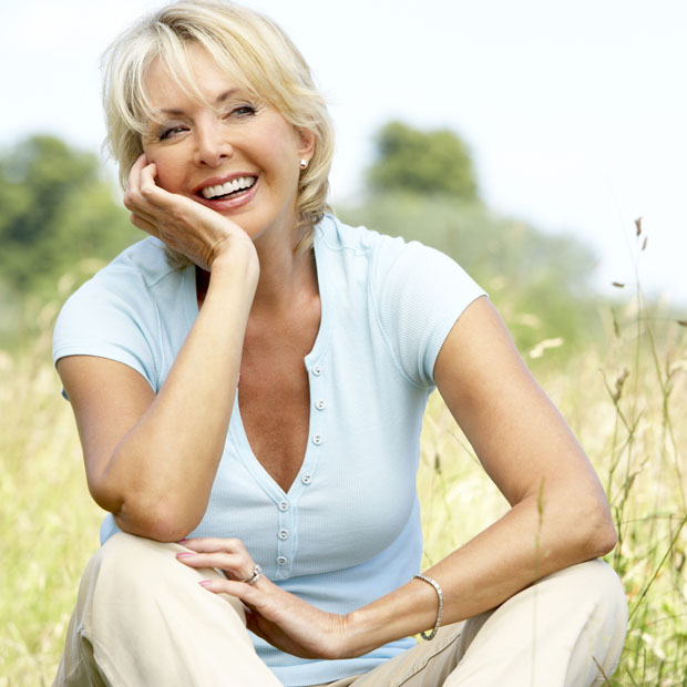 Mature woman sitting in countryside